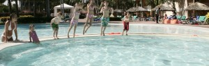 Kids jump in pool